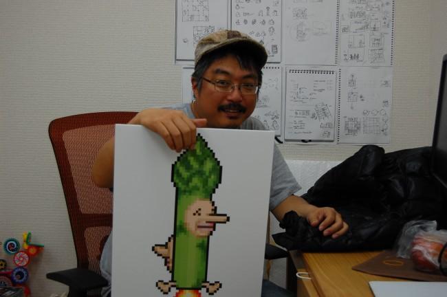 ゲーム内のキャラクター「アスパラさん」と木村祥朗氏